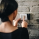 Young-Woman-Entering-Security-Code-alarm-system