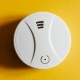 smoke-detector-yellow-ceiling-residential-security-device