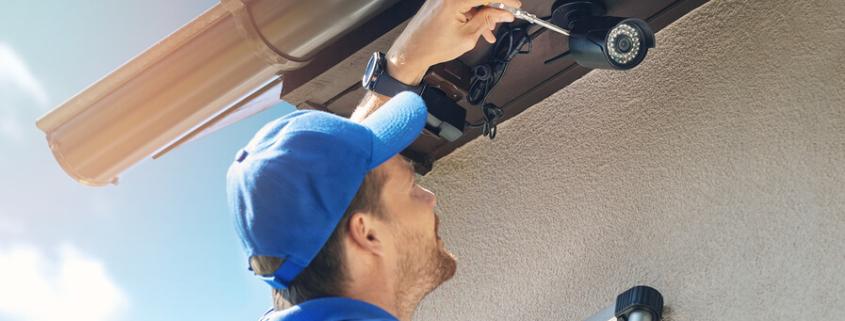 Man-Install-Outdoor-Surveillance-camera-system