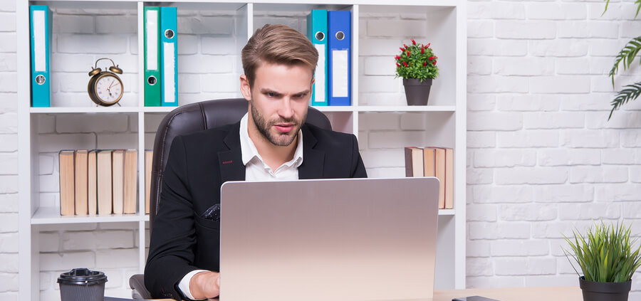 business-man-working-remotely-on-the-computer